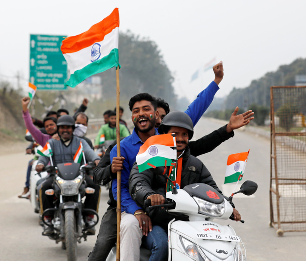 Residents on the Indian side of the border celebrate before the arrival of an Indian Air Force pilot who was captured by Pakistan.