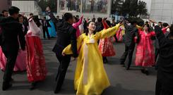 Voting with their feet: North Koreans dance during election day at a polling station in Pyongyang. AP photo