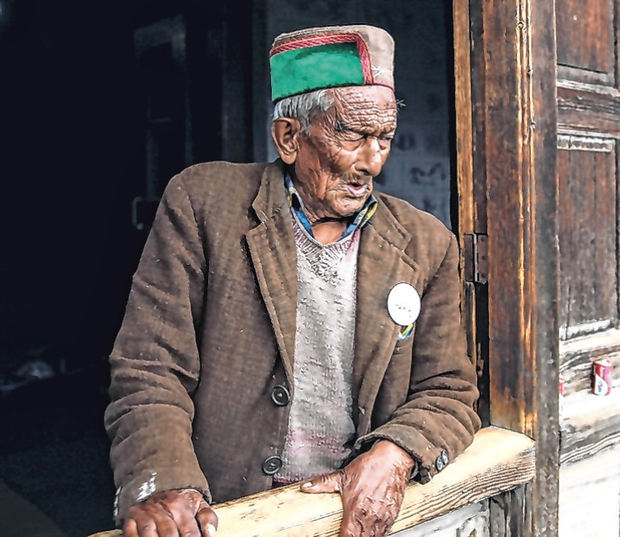 Shyam Saran Negi, who is aged 102 and has voted in all elections since 1951, waits to go the polling station. Photo: Reuters