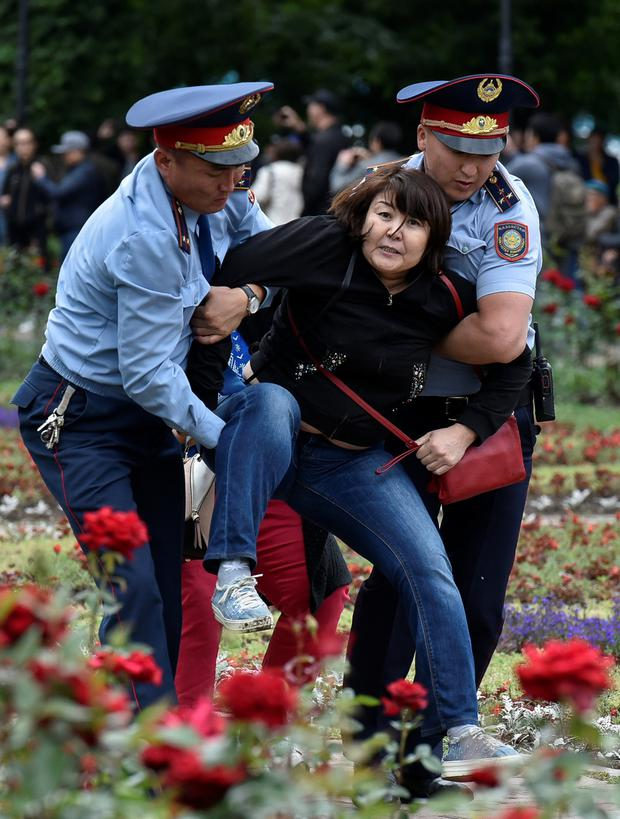 Dragged: Police officers detain an opposition supporter during a protest in Almaty, Kazakhstan. Photo: Reuters
