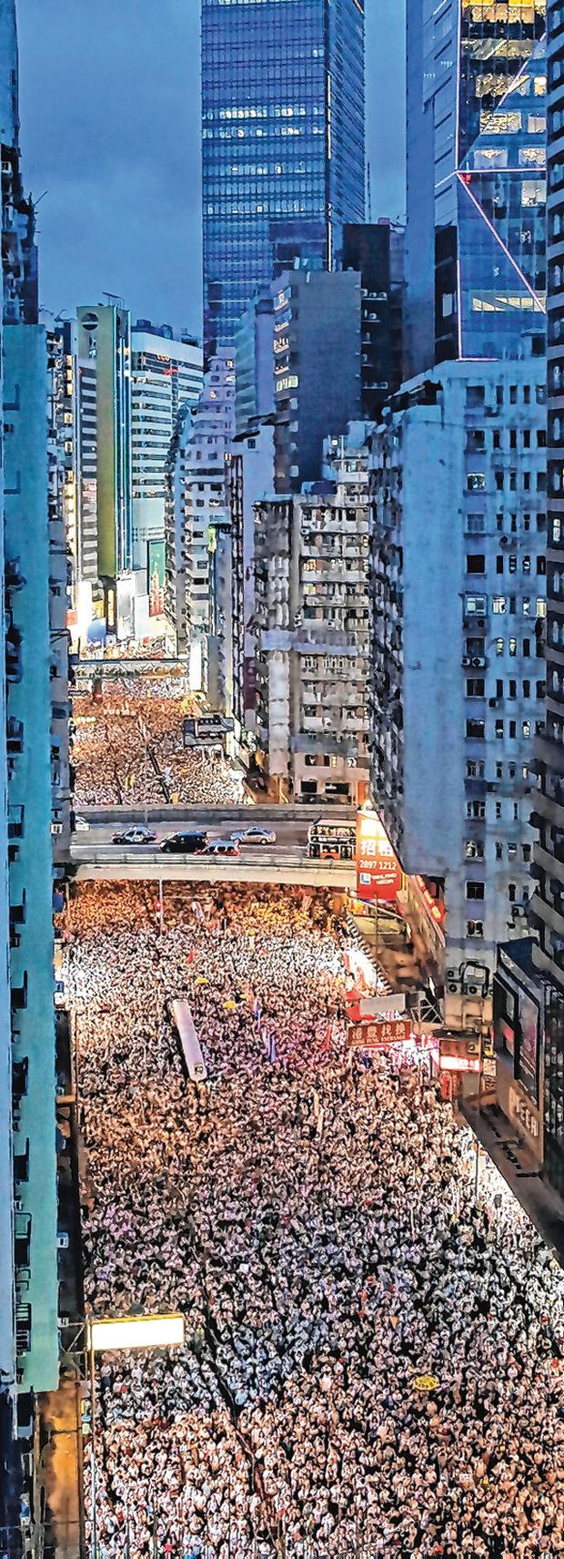 A sea of protesters marches through the centre of the city. Photo: AP