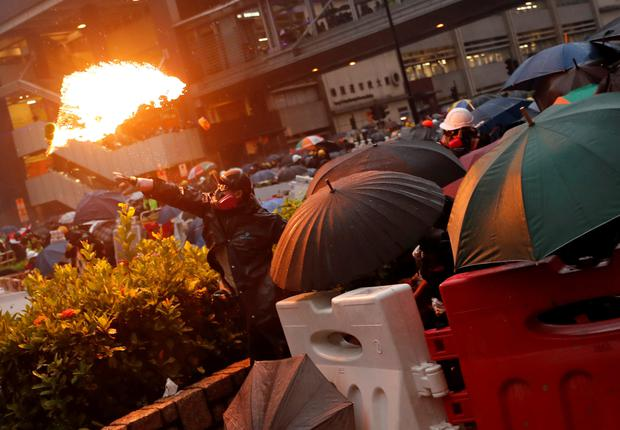 A protester throws a Molotov cocktail at police. Photo: Reuters