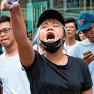Challenge: An anti-government protester shouts at police during a protest in the Tsuen Wan district. Photo: Reuters