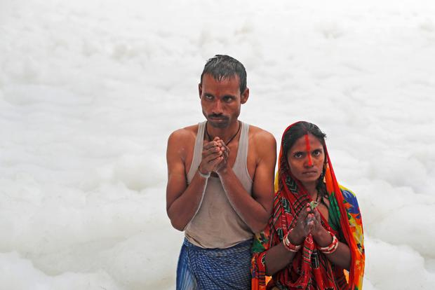 Praying: A Hindu couple worships the sun god in the polluted waters of the river Yamuna during the Hindu religious festival of Chatth Puja in New Delhi. Photo: Adnan Abidi/Reuters