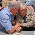 Emotion: Australian Prime Minister Scott Morrison comforts Owen Whalan (85) who was among thousands of people evacuated from their homes north of Sydney