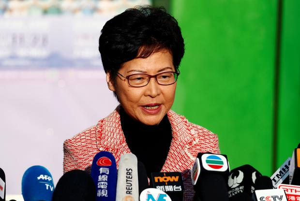 Upbeat: Hong Kong chief executive Carrie Lam speaks to the media after voting