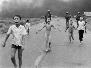 Kim Phuc and other children flee the terror of a napalm attack in Vietnam