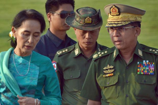 Aung San Suu Kyi (left) shown in a file photo with Senior Gen Min Aung Hlaing(right), Myanmar's army chief.Photo: AP/Aung Shine Oo