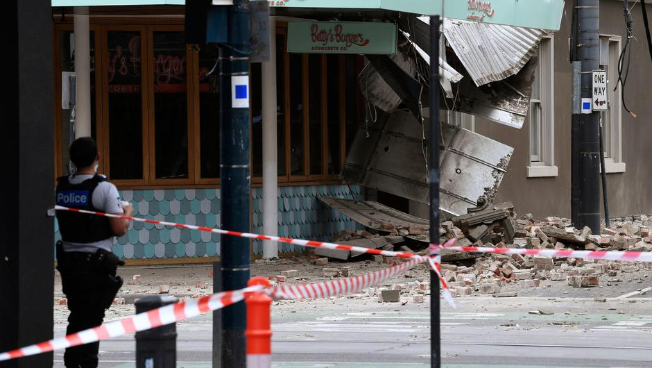 Debris is scattered in the road after an earthquake damaged a building in Melbourne. AP