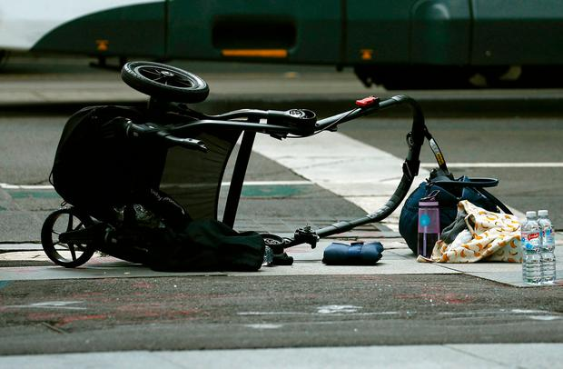 A pram is seen as police cordon off Bourke Street mall, after a car hit pedestrians in central Melbourne, Australia, January 20, 2017. REUTERS/Edgar Su