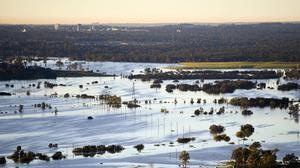 Floodwater covers large areas northwest of Sydney, Australia, Wednesday, March 24, 2021. Some 18,000 residents of Australia's most populous state have fled their homes since last week, with warnings the flood cleanup could stretch into April. (Lukas Coch/Pool Photo via AP)