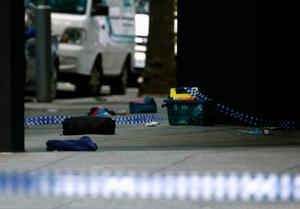Belongings lie scattered on a footpath after police cordoned off Bourke Street mall, after a car hit pedestrians in central Melbourne, Australia, January 20, 2017. Photo: REUTERS/Edgar Su