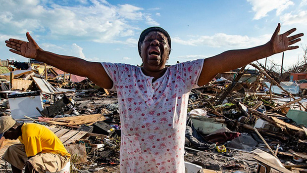 Despair: Aliana Alexis stands on the concrete slab of what is left of her home after destruction from Hurricane Dorian in an area called 'The Mud' at Marsh Harbour in Great Abaco Island, Bahamas. Photo: Al Diaz/Miami Herald/AP