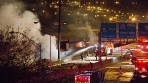 Smoke billows from a section of an overpass which collapsed after a large fire on Interstate 85 in Atlanta, Georgia (AP)