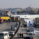 An Iranian plane on a road outside Mahshahr Airport after skidding off the runway (Mohammad Zarei/ISNA via AP)