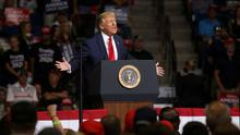 Mass gathering: President Donald Trump speaks at the rally in Tulsa. Photo: REUTERS