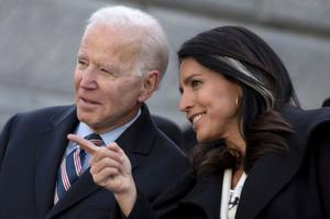 Support: Joe Biden speaks with his fellow Democrat Tulsi Gabbard. Photo: Sam Wolfe/Reuters