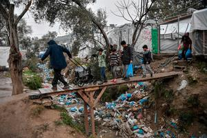 SQUALID: A man drags a cart with water in the overcrowded Moria migrant camp on the Greek Aegean island of Lesbos last week. Photo: Louisa Gouliamaki/Getty