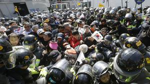 Supporters of South Korean President Park Geun-hye are blocked by police as they march towards Constitutional Court in Seoul (Ahn Young-joon/AP)