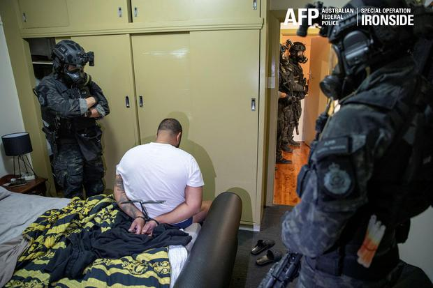 A person is detained by Australian Federal Police after its Operation Ironside against organised crime. Picture: Reuters/Australian Federal Police.
