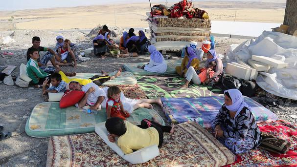 Displaced Yazidis settle at the Qandil mountains near the Turkish border outside Zakho, 300 miles north west of Baghdad (AP)