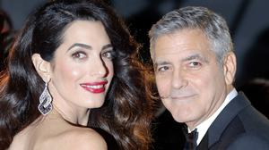 George Clooney and his wife Amal on the red carpet of the Cesar Film Awards in Paris (AP)