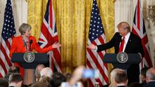 US President Donald Trump and British Prime Minister Theresa May gesture towards each other during a news conference in the East Room of the White House in Washington yesterday. Photo: AP