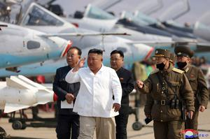 Absent: North Korean leader Kim Jong-un inspects an air defence unit in an undated photo released by his government on April 12. Photo: AP