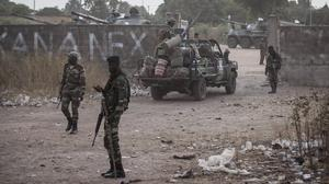 Senegal soldiers providing security at their gathering point on the Gambia border with Senegal at the town of Karang (AP Photo/Sylvain Cherkaoui)