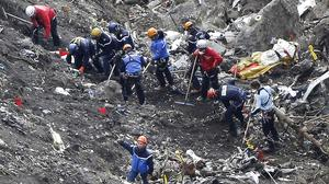 Rescue workers scour debris of the Germanwings jet at the crash site near Seyne-les-Alpes, France (AP)