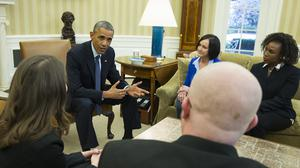 Barack Obama meets letter writers who will be in the White House Oval Office for his State of the Union address (AP)