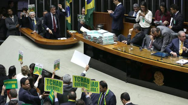 Brazil's attorney general Jose Eduardo Cardozo, top left, presents the defence of President Dilma Rousseff in the Chamber of Deputies (AP)