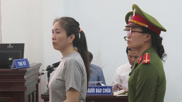 Prominent blogger Nguyen Ngoc Nhu Quynh, left, stands trial in the south central province of Khanh Hoa, Vietnam (Vietnam News Agency via AP)