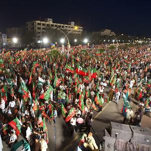 Supporters of Pakistan Tehreek-e-Insaf or Moment for Justice party attend a campaign rally in Islamabad ahead of parliamentary elections (AP)