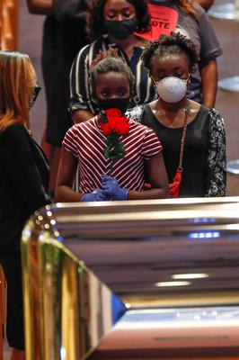 Mourners view Floyd's casket at The Fountain of Praise church in Houston, Texas. Photo: Godofredo A. Vasquez/Pool via Reuters