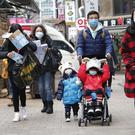 People wear masks at a shopping district in Seoul, South Korea (Ahn Young-joon/AP)