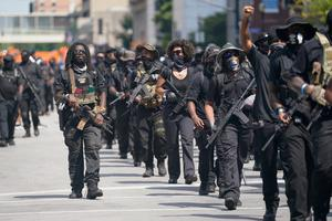 Separatists: Members of an all-black militia group called NFAC hold an armed rally in Louisville, Kentucky, on Saturday. Photo: Bryan Woolston/Reuters