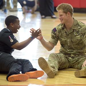 Prince Harry gives a high five to Lcpl Maurillia Simpson as he meets British soldiers competing in the Warrior Games (Arthur Edwards/The Sun /PA)
