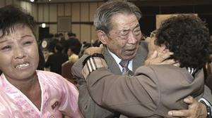 South Korean Min Ho-shik hugs his North Korean family member Min Un Sik during the Separated Family Reunion Meeting at Diamond Mountain resort in North Korea (Kim Do-hoon/Yonhap via AP)