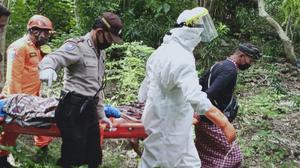 In this photo released by Indonesian National Search And Rescue Agency (BASARNAS), rescuers carry Ukrainian man Roberts Jacob Matthews on stretcher in Pecatu, Bali, Indonesia, on June 6, 2020. Matthews, who fell into an abandoned well and broke his leg while being chased by a wild dog on Indonesia's tourist island of Bali, was rescued after being trapped for nearly a week, police said Monday, June 8, 2020. (BASARNAS via AP)