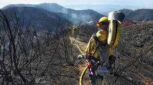 Firefighters tackled major wildfires in California towards the end of 2017 (Santa Barbara County Fire Department /AP)