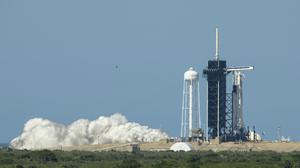 A SpaceX Falcon 9 rocket with the company's Crew Dragon spacecraft onboard is seen on a launch pad (Bill Ingalls/NASA via AP)