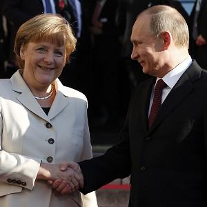 German chancellor Angela Merkel welcomes Russian president Vladimir Putin for the opening of the Hannover Fair in Germany (AP)