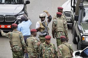 A member of Kenyan special forces at the scene of the attack in Nairobi (Ben Curtis/AP)