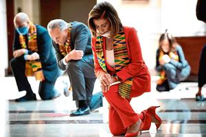 Aftermath: Speaker of the House Nancy Pelosi and other Democratic politicians take a knee to observe a moment of silence for George Floyd. Photo: Brendan Smialowski / AFP