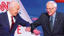 Cautious greeting: Former vice president Joe Biden, left, and Senator Bernie Sanders greet one another by touching elbows due to social distancing before the Democratic debate