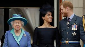 ALL CHANGE AT WINDSOR: Queen Elizabeth, Meghan and Harry. AP photo