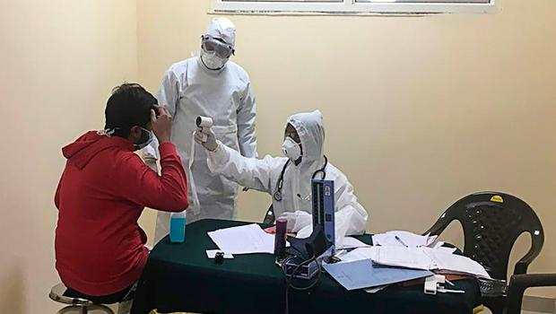 Health officials check a man from Wuhan at the Chhawla facility, in New Delhi. Picture: AFP