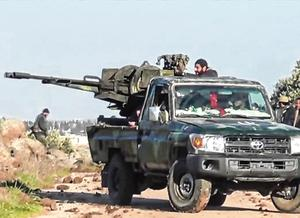Offensive: Syrian army soldiers firing a weapon as they advance on the town of Kfar Nabl in Syria. Photo: Reuters TV