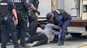 Outrage: A man is arrested during protests in Louisville, Kentucky. PHOTO: REUTERS